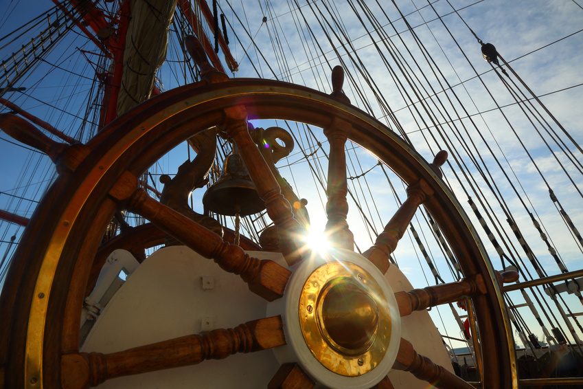 background for sea travel - the old wheel and rigging